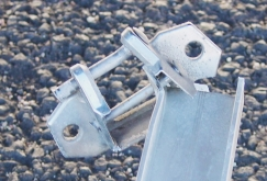 Photo of a broken bracket and support arm.
